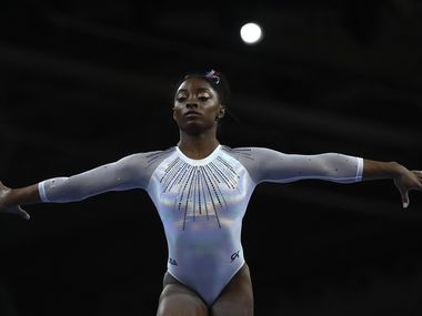 Simone Biles of the United States performs on the balance beam in the women's all-around final at the Gymnastics World Championships in Stuttgart, Germany, Thursday, Oct. 10, 2019. (AP Photo/Matthias Schrader)