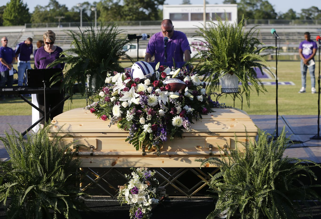 """Moment of silence led by Newton High School assistant principal Tabor Westbrook during the memorial service for Newton High School head football coach William Theodore """"W.T."""" Johnston at Curtis Barbay Field at Newton High School in Newton, Texas on Wednesday, May 15, 2019. (Vernon Bryant/The Dallas Morning News)"""