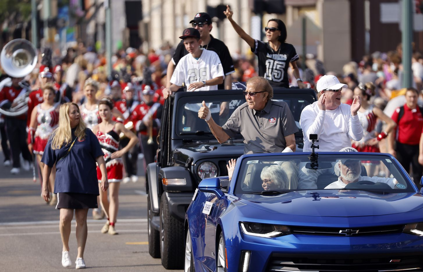 Oakland Raiders coach and Pro Football Hall of Fame inductee Tom Flores gives a thumbs up to fans as he rides in the Canton Repository Grand Parade in downtown Canton, Ohio, Saturday, August 7, 2021. The parade honored newly elected and former members of the Hall. (Tom Fox/The Dallas Morning News)