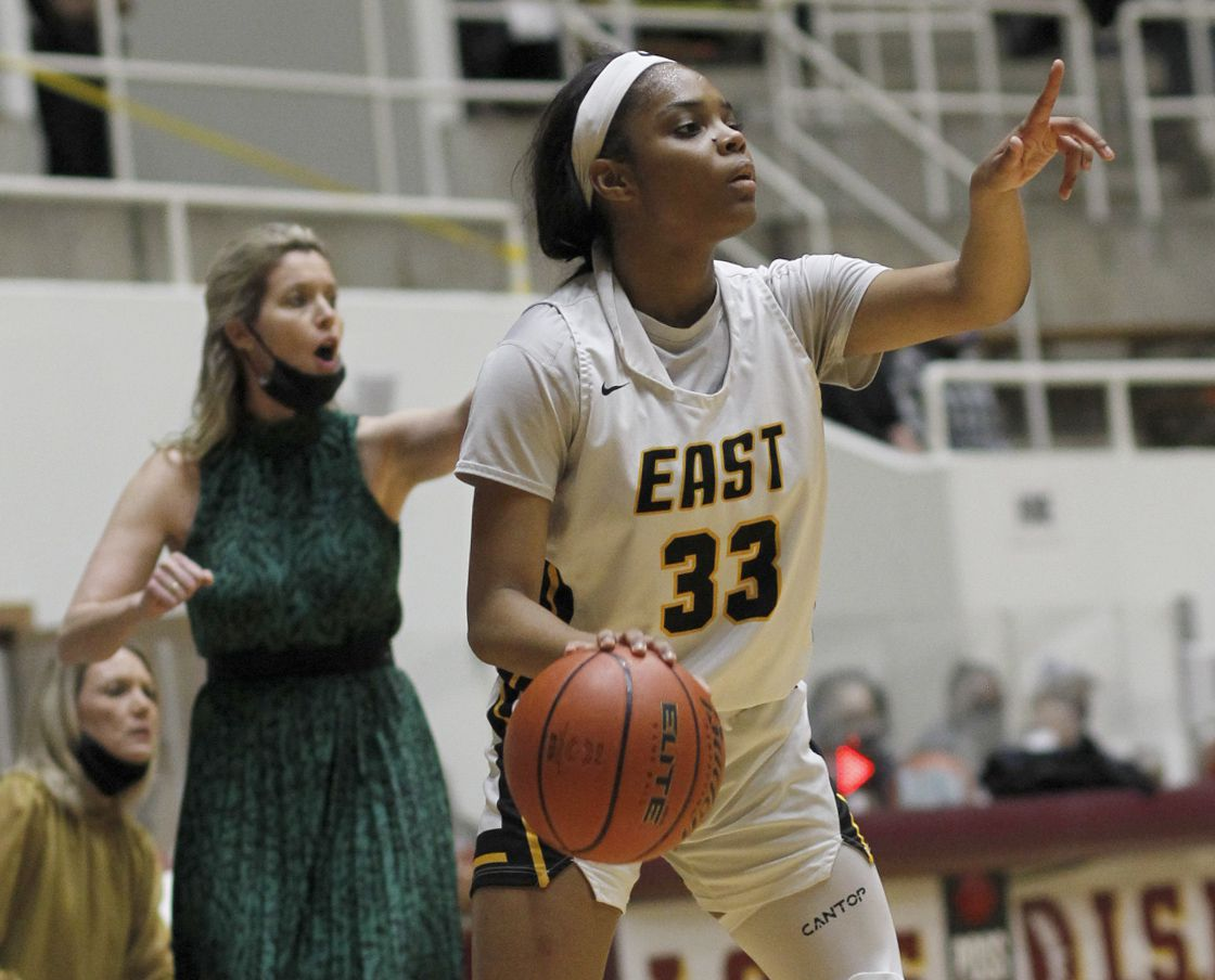 Plano East guard Tiana Amos (33) visually peruses all of her passing options during first half action against Southlake Carroll. Plano East won 56-42 to advance. The two teams played their Class 6A regional semifinal girls playoff basketball game at Loos Field House in Addison on February 27, 2021. (Steve Hamm/ Special Contributor)