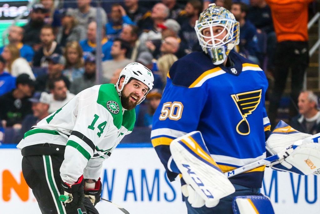 Dallas Stars left wing Jamie Benn (14) looks at St. Louis Blues goaltender Jordan Binnington (50) during a timeout during the second period in game 5 of an NHL second round playoff series at Enterprise Center in St. Louis, Missouri on Friday, May 3, 2019.(Shaban Athuman/Staff Photographer)