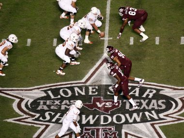 Texas Longhorns offensive linesman Nick Zajicek (55) lines up in formation against the Aggies defense by the Lone Star Showdown logo during the first half of the Texas A&M Aggies vs University of Texas Longhorns rivalry NCAA football game at Kyle Field on Thanksgiving Day, Thursday, November 24, 2011 in College Station, Texas. (Patrick T. Fallon/The Dallas Morning News)