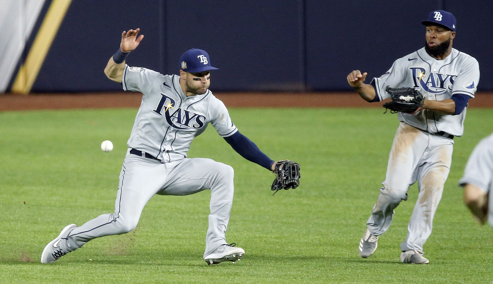 Tampa Bay Rays center fielder Kevin Kiermaier (left) almost collides with right fielder Manuel Margot (right) as he attempted to catch Los Angeles Dodgers Justin Turner's double during the eighth inning in Game 2 of the World Series at Globe Life Field in Arlington, Wednesday, October 21, 2020. (Tom Fox/The Dallas Morning News)