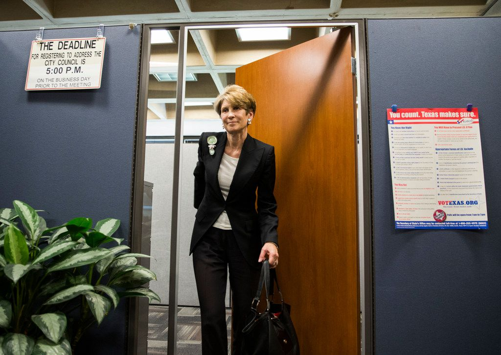Former Dallas Mayor Laura Miller leaves the city secretary's office after filing the required petition signatures to secure a place on the ballot for Dallas City Council District 13 at City Hall.