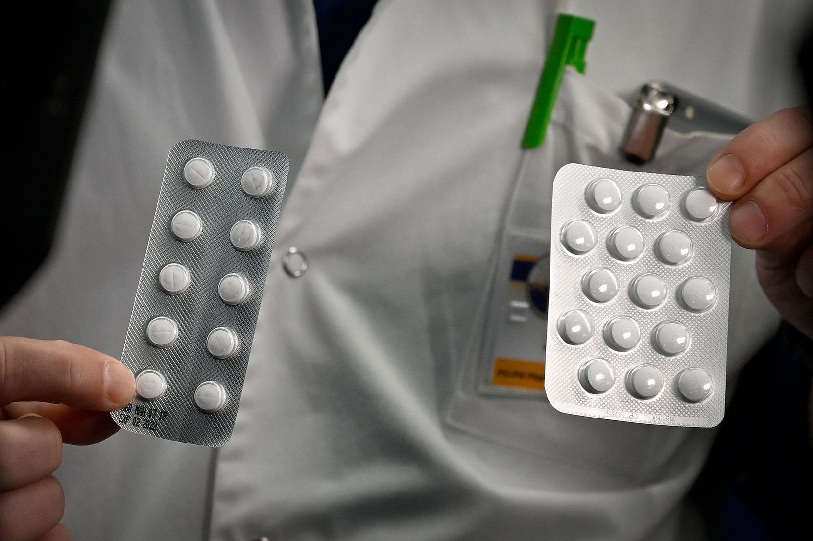 Medical staff at the IHU Mediterranee Infection Institute in Marseille show packets of Nivaquine, tablets containing chloroquine, and Plaqueril, tablets containing hydroxychloroquine. Anecdotal evidence suggests the drugs could help fight COVID-19.