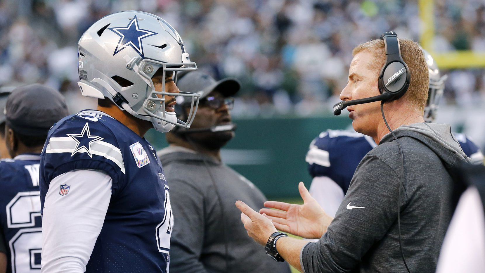 Dallas Cowboys head coach Jason Garrett confers with quarterback Dak Prescott (4) before he heads back on the field in the first half against the New York Jets at MetLife Stadium in East Rutherford, New Jersey, Sunday, October 13, 2019.
