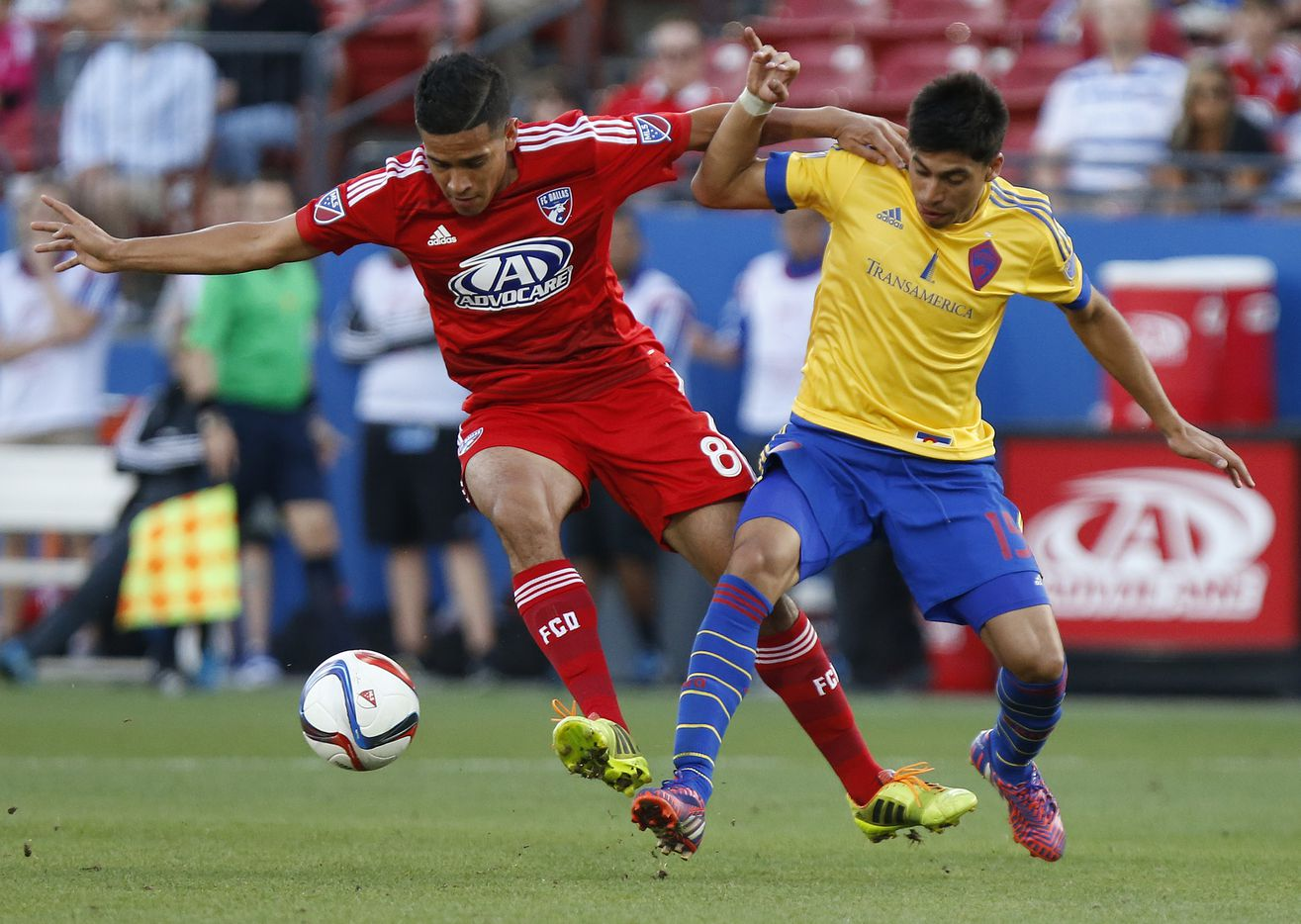 FC Dallas midfielder Victor Ulloa (8) battles for position with Rapids midfielder Juan Ramirez (15) during the second half as FC Dallas hosted the Colorado Rapids on Friday evening, April 10, 2015.  (Special Contributor/Stewart F. House)