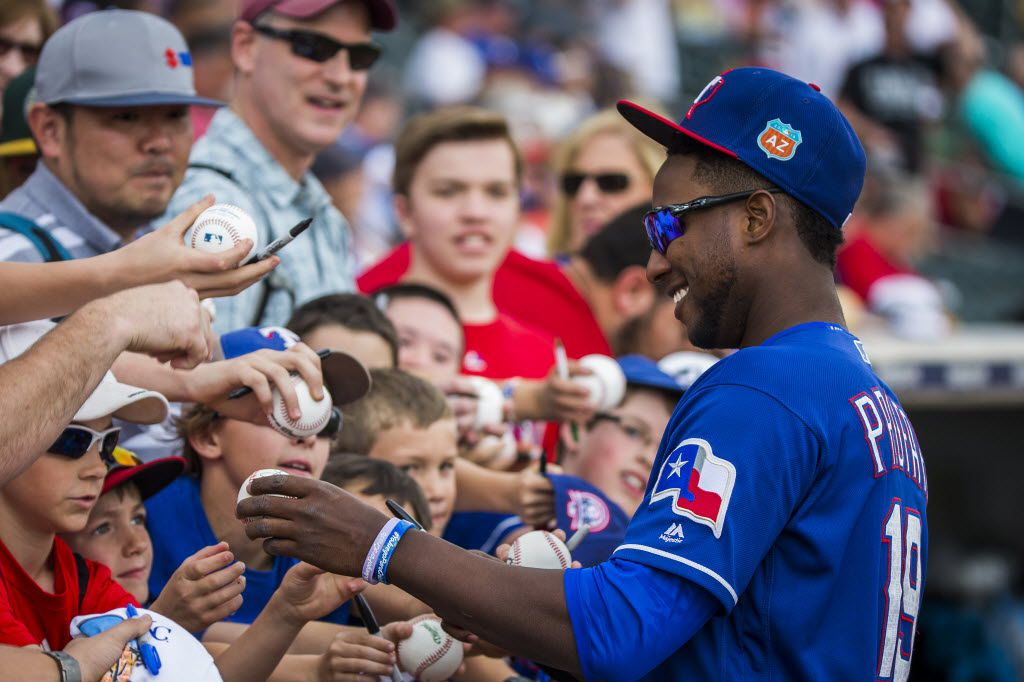 Texas Rangers infielder Jurickson Profar signs autographs before a spring training game against the Seattle Mariners at Surprise Stadium on Sunday, March 6, 2016, in Surprise, Ariz. (Smiley N. Pool/The Dallas Morning News)