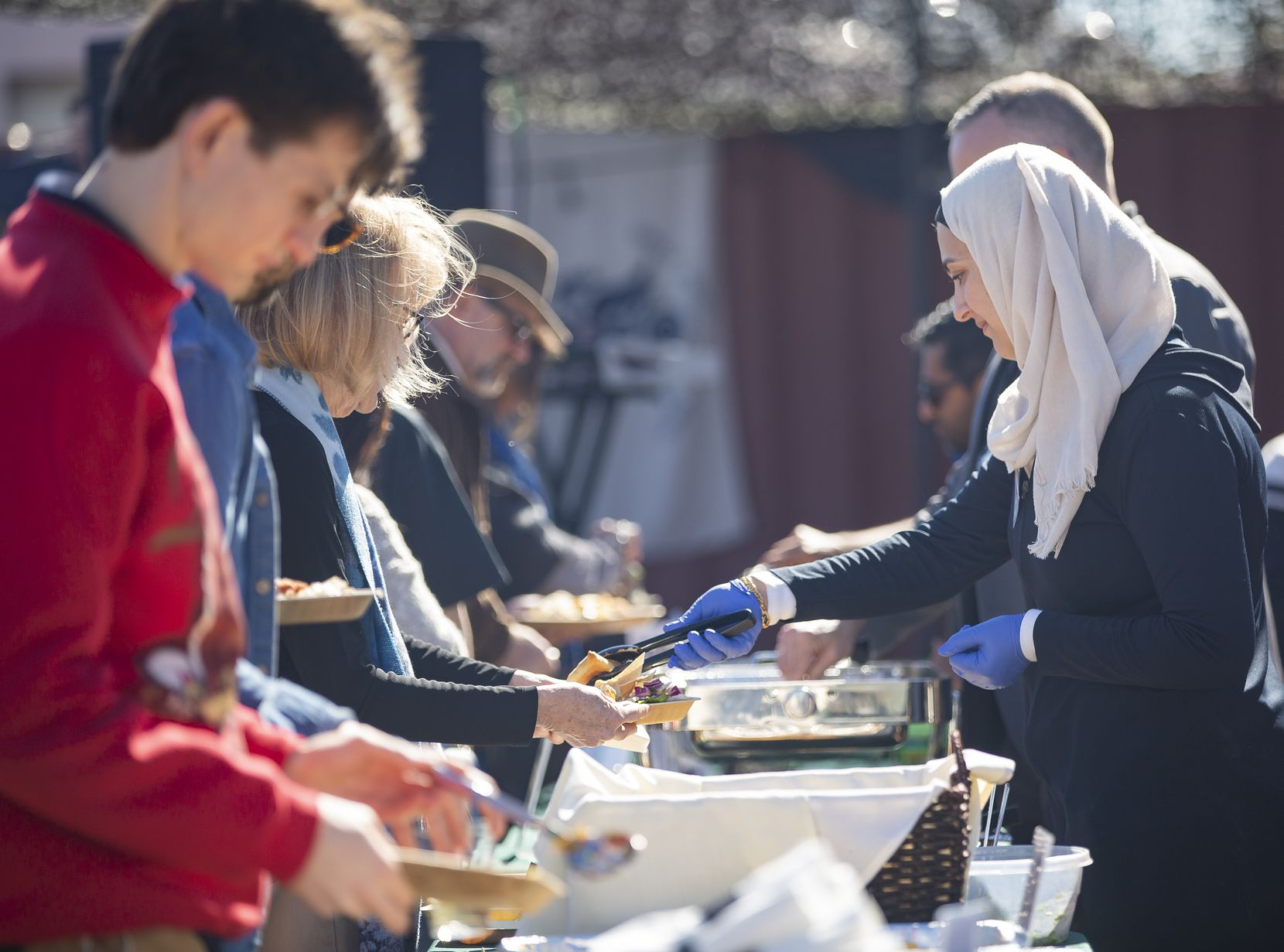 Members of Break Bread, Break Borders serve Iraqi and Syrian dishes and barbecue during an event in partnership with Nasher Prize winner Michael Rakowitz at the F.A.R.M., Farmers Assisting Returning Military.