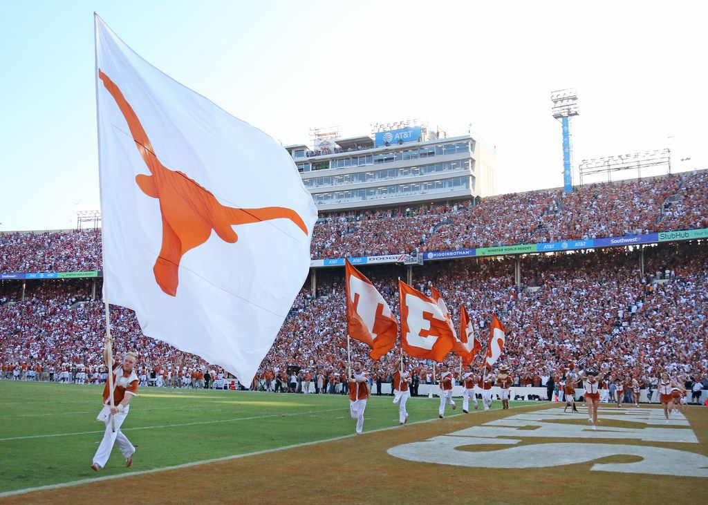The Longhorns celebrate after a Texas score during the Oklahoma University Sooners vs. the University of Texas Longhorns NCAA college football game at the Cotton Bowl in Dallas on Saturday, October 14, 2017. (Louis DeLuca/The Dallas Morning News)