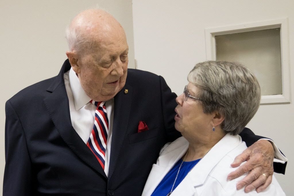 Steven Landregan greets Sister Dawn Achs during Landregan and Tony Ramirez's retirement party at Diocese of Dallas Pastoral Center on June 23, 2016.