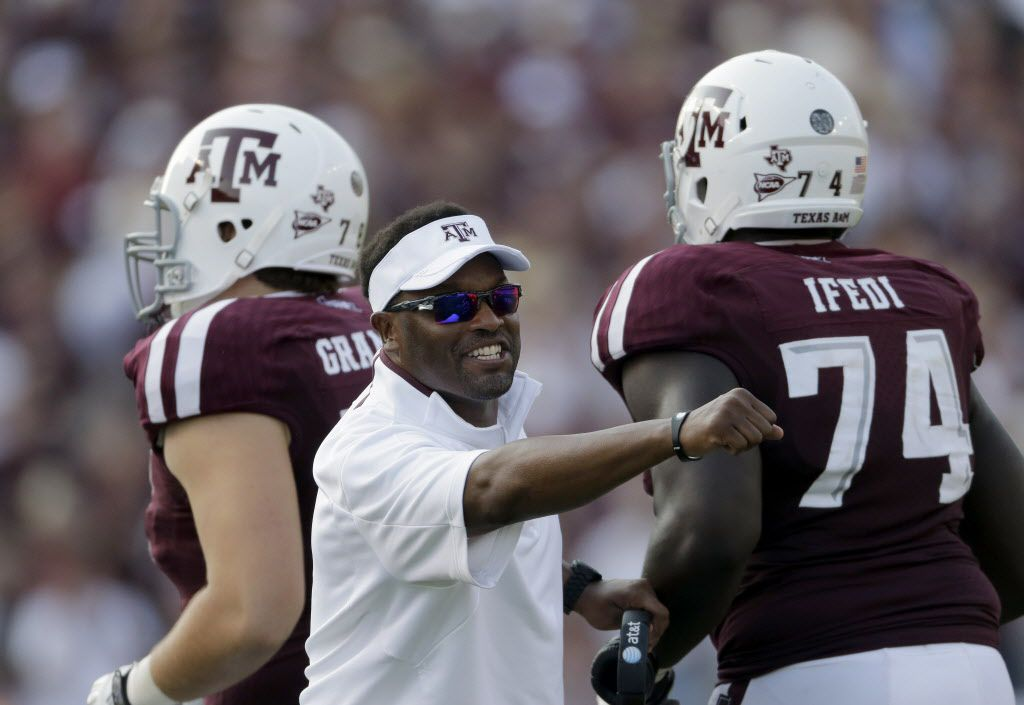 Texas A&M head coach Kevin Sumlin celebrates after a touchdown against Alabama during the fourth quarter of an NCAA college football game Saturday, Sept. 14, 2013, in College Station, Texas. (AP Photo/David J. Phillip)