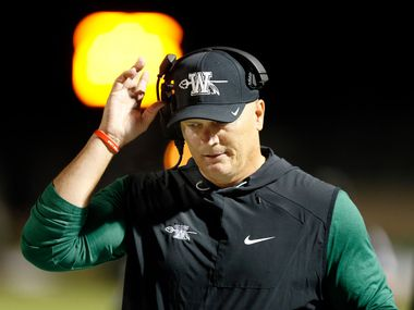Waxahachie head coach Jon Kitna paces the sideline in the first half against Mansfield Legacy at Vernon Newsom Stadium in Mansfield, Texas, Friday, October 20, 2017. (Tom Fox/The Dallas Morning News)