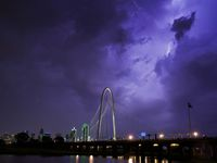 Lightning illuminates the sky over the Margaret Hunt Hill Bridge as a storm rolls over downtown Dallas on Thursday, May 7, 2020.  (Smiley N. Pool/The Dallas Morning News)