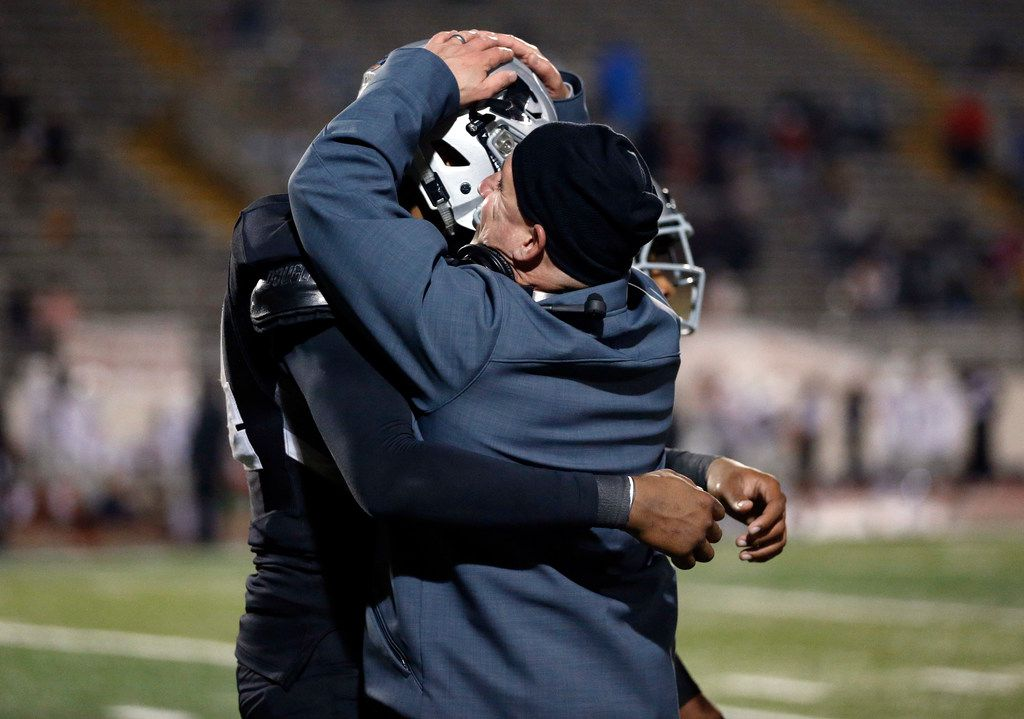 Martin head coach Bob Wager gives his defensive lineman Ernest Cooper IV a big hug after he returned a punt block for a touchdown against Bowie in the second half at Maverick Stadium in Arlington, Texas, Thursday, November 7, 2019. Martin won the district title, 44-19. (Tom Fox/The Dallas Morning News)
