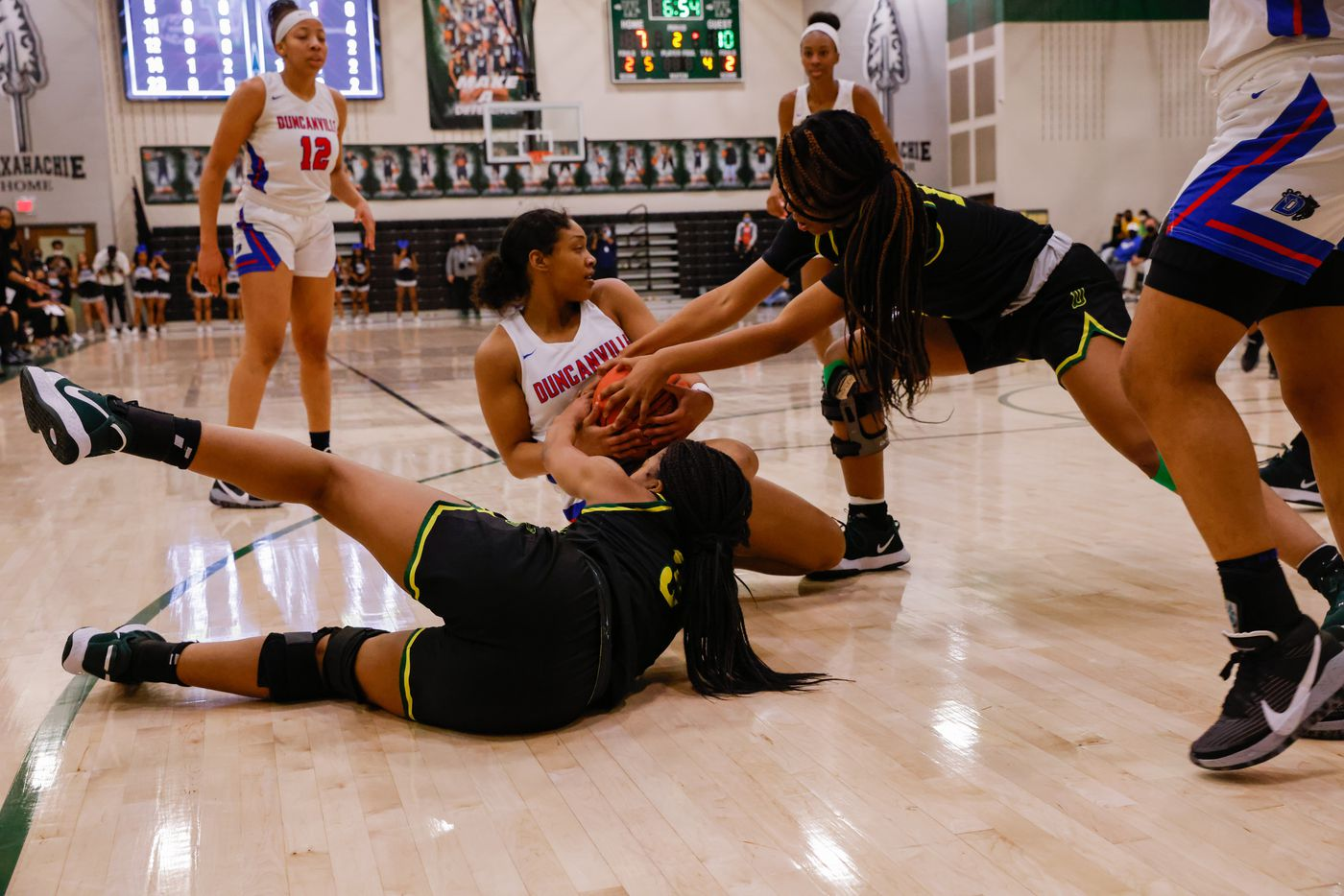 Duncanville's Kiyara Howard-Garza (5) attempts to protect the ball from DeSoto during the first half of a UIL girls basketball Class 6A Region II in Waxahachie on Tuesday, March 2, 2021. (Juan Figueroa/ The Dallas Morning News)