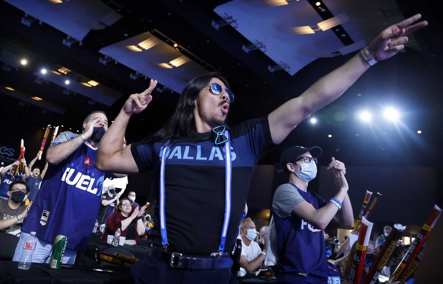 Dallas Fuel fans cheer player Sp9rk1e at the completion of his live winning interview. The Fuel defeated the Houston Outlaws in their Overwatch League match at Esports Stadium Arlington Friday, July 9, 2021. They won The Battle for Texas, 3-0. It was the first in-person live competition for fans in over a year. Houston competed from their hometown. (Tom Fox/The Dallas Morning News)