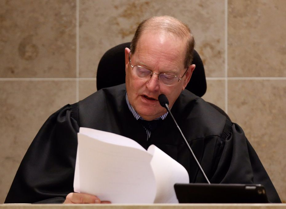 District Judge Mark Rusch reads the charge to the jurors during the trial of Enrique Arochi last year.