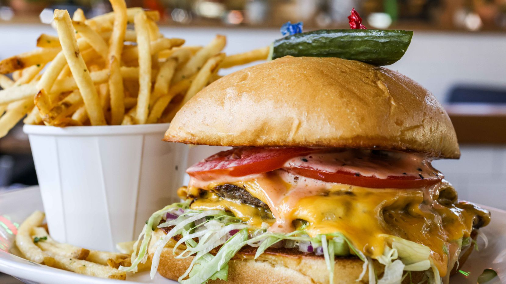 You want a burger? National Anthem, a new restaurant in downtown Dallas' East Quarter, has a gorgeous one.