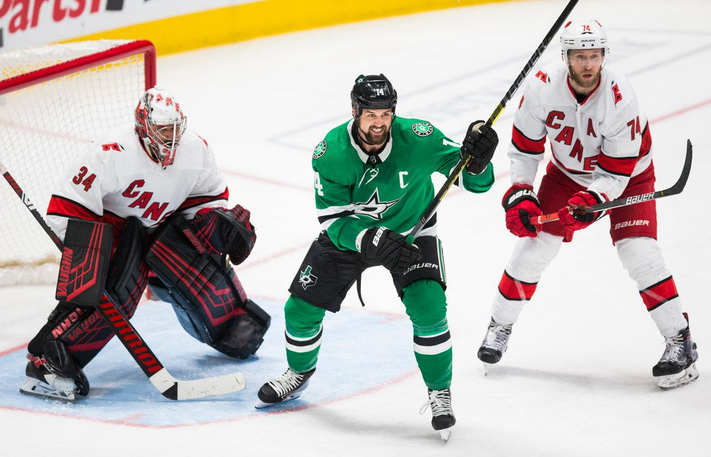 Dallas Stars left wing Jamie Benn (14) looks for an assist between Carolina Hurricanes goaltender Petr Mrazek (34) and defenseman Jaccob Slavin (74) during the third period of an NHL game between the Dallas Stars and the Carolina Hurricanes on Tuesday, February 11, 2020 at American Airlines Center in Dallas. (Ashley Landis/The Dallas Morning News)