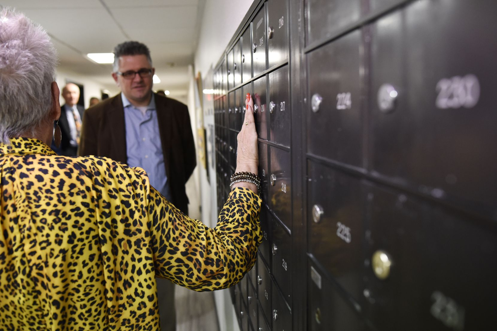 Cindy Montgomery, St. Jude Center's property manager, tells Mark Calabria,  director of the Federal Housing Finance Agency, that the mailboxes here are as important as any activity room or library.