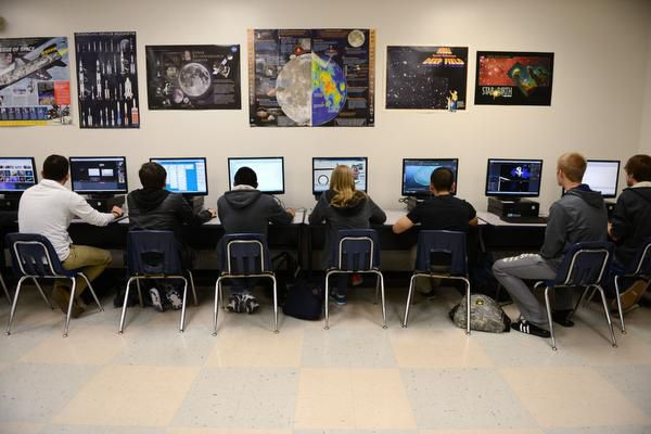 Students work on their project to develop an educational computer game to teach middle-school students about the dangers of asteroids during a computer science class at Sachse High School on April 10, 2014. The new class combines computer animation and computer science III classes, and the computer game project itself is in partnership with NASA.