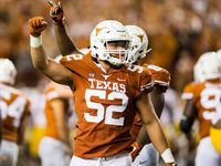 Texas Longhorns offensive lineman Samuel Cosmi (52) celebrates a field goal at the end of the second quarter of an NCAA football game between the Texas Longhorns and the USC Trojans on Saturday, September 15, 2018 at Darrell K Royal Memorial Stadium in Austin, Texas. (Ashley Landis/The Dallas Morning News)