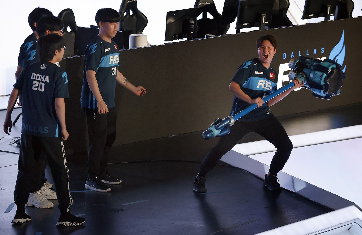Dallas Fuel player Fearless (right) yells before slamming Reinhardt's hammer, knocking over his teammates during their Overwatch League introductions at Esports Stadium Arlington Friday, July 9, 2021. Dallas Fuel defeated the Houston Outlaws in The Battle for Texas, 3-0. It was the first in-person live competition for fans in over a year. Houston competed from their hometown. (Tom Fox/The Dallas Morning News)