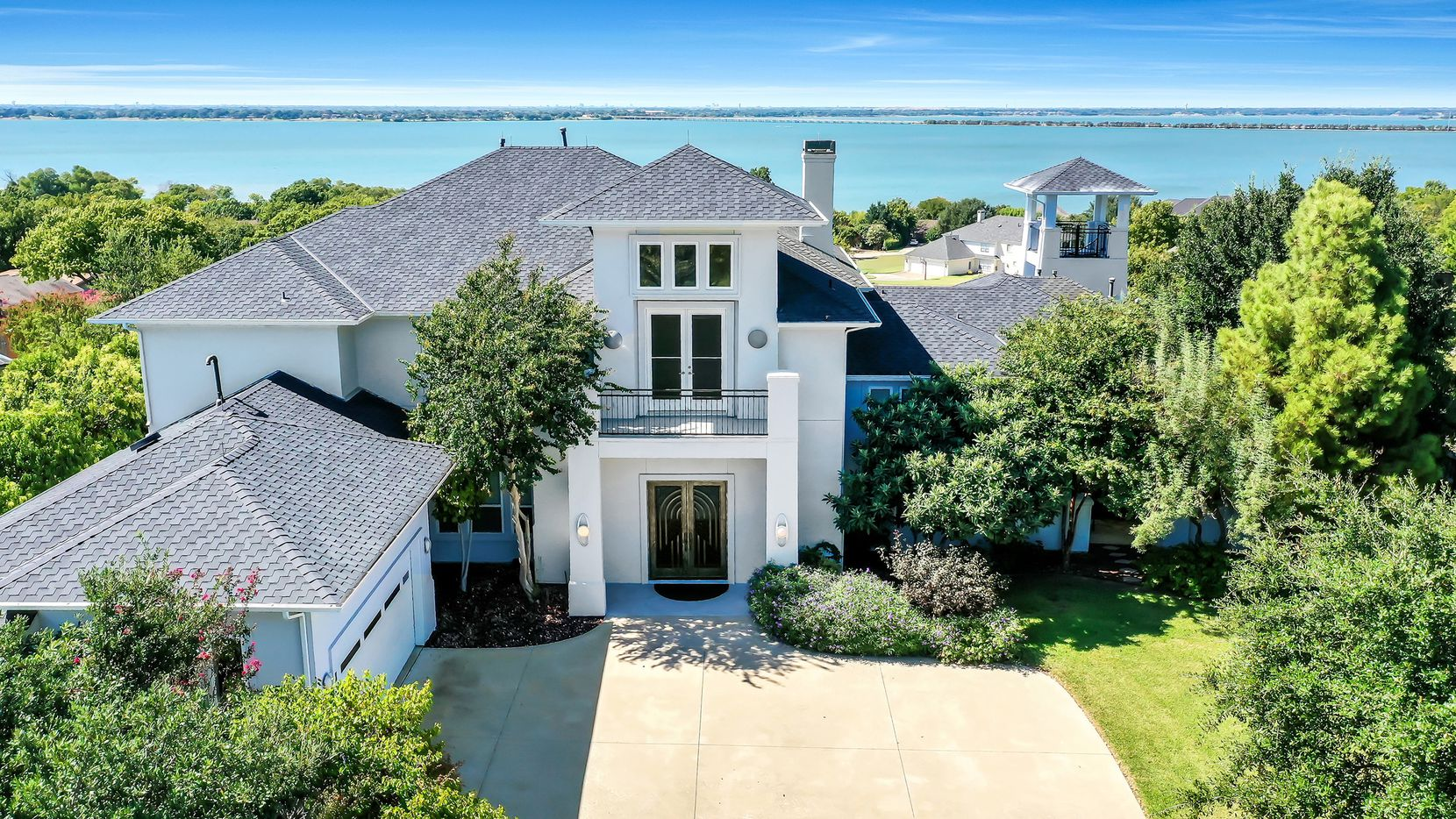 Offered for $1,399,000, the estate at 1724 Ridge Road in Rockwall features unobstructed lake views and abundant indoor/outdoor space for entertaining.