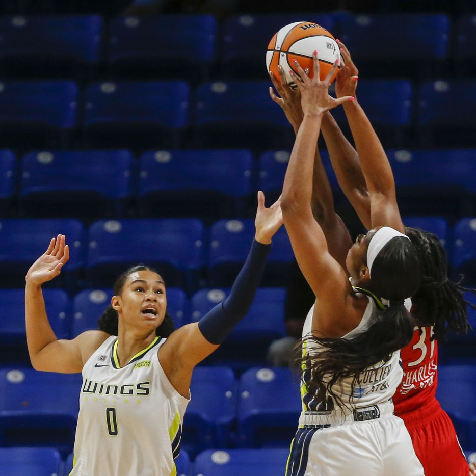 Dallas Wings forwards Satou Sabally (0) and Charli Collier (35) jump for a rebound with Washington Mystics center Tina Charles (31) during the first quarter at College Park Center on Saturday, June 26, 2021, in Arlington. (Elias Valverde II/The Dallas Morning News)