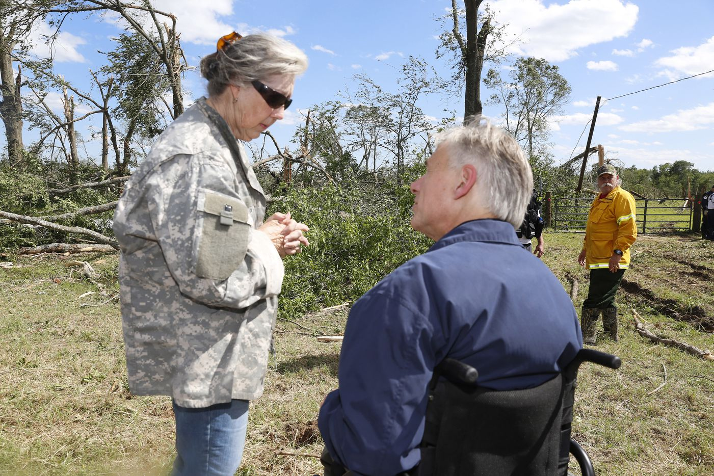 Darlynn Young explains the tornado damage of her niece's property along FM243 in Canton to Governor Greg Abbott Sunday afternoon April 30, 2017. Her niece, Patrice Reed, was not  home at the time of the tornado.