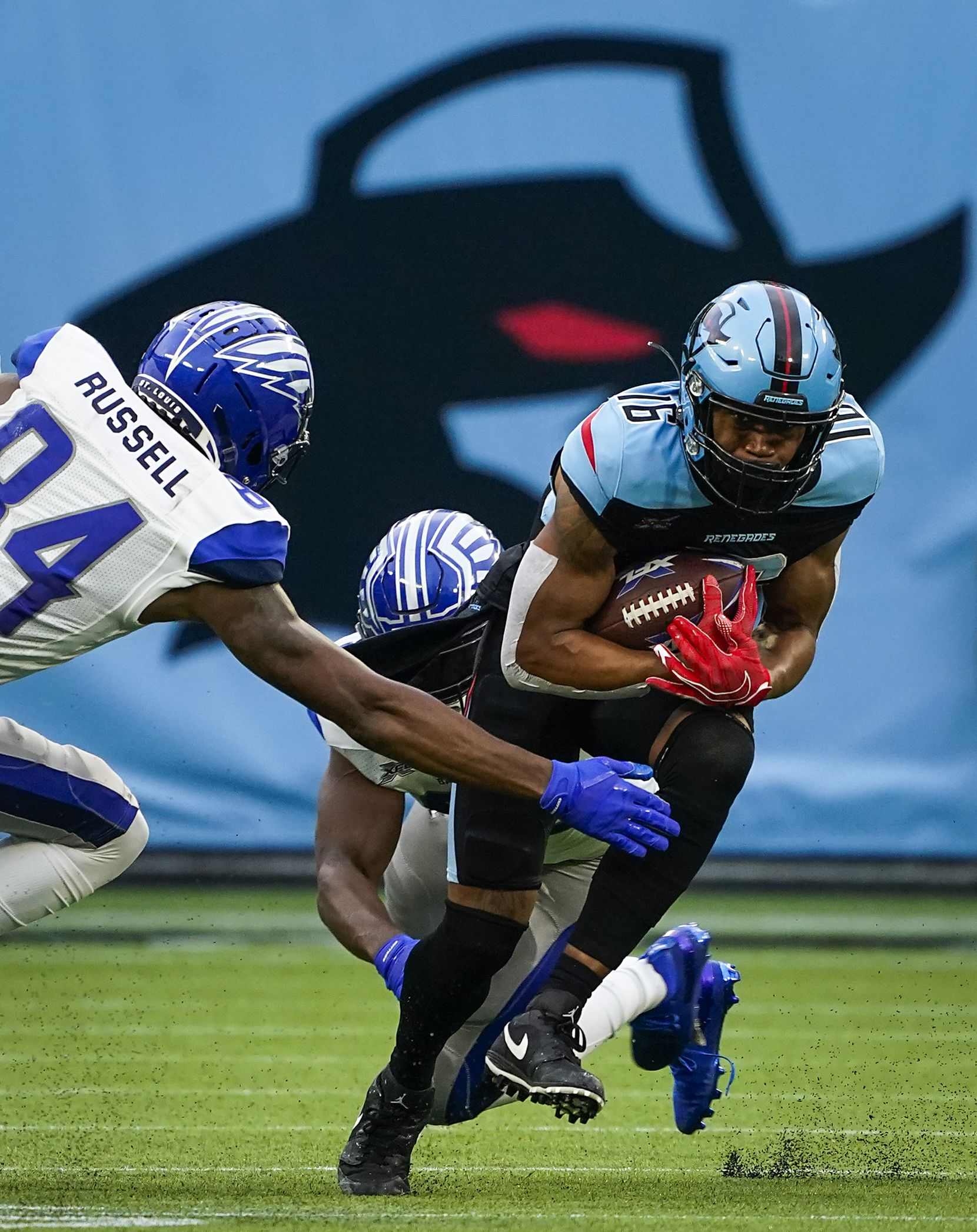 Dallas Renegades wide receiver Jerrod Heard (16) is brought down by the St. Louis Battlehawks Alonzo Russell (84) and Steve Beauharnais (58) during the first half of an XFL football game at Globe Life Park on Sunday, Feb. 9, 2020, in Arlington.