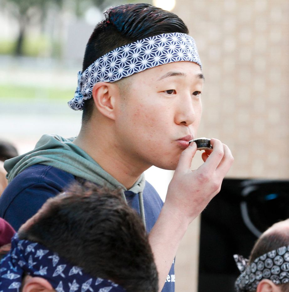 Chris Tak from Irving eats a piece of vegetable roll while attempting to eat five feet of sushi in the first Sushi Speed Eating Contest at Kabuki Restaurant on Saturday,  April 6, 2019 in Irving, Texas. (Brian Elledge/The Dallas Morning News)