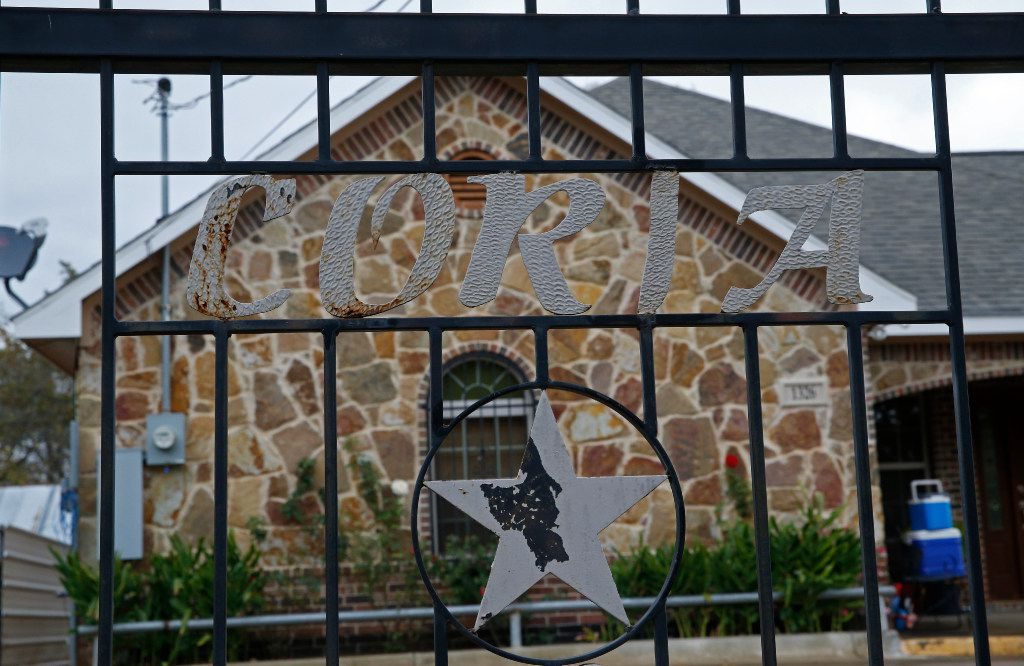 The Coria family name has been welded into the gate of one of the homes in southern Dallas. It belongs to one of Coria's brothers, records show.