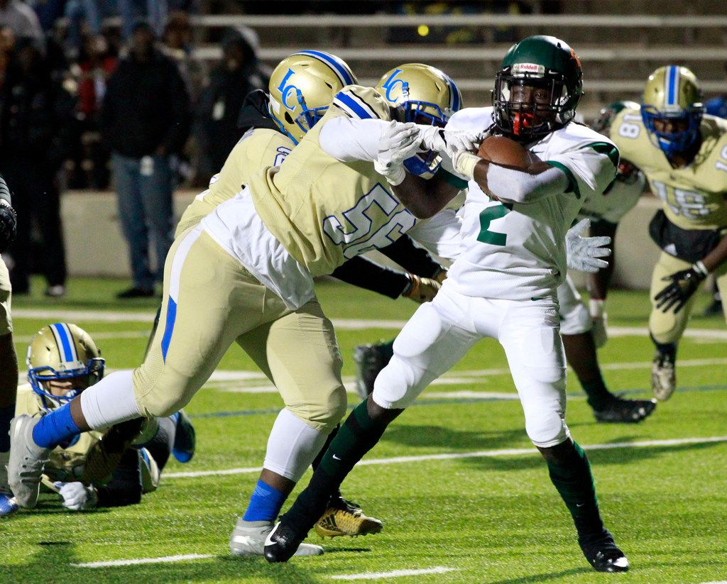 Naaman Forest Sir Coleman (2) scores a touchdown, as Lakeview defender Abdulhadi Darkazalli (56) can't make the stop during the first half of the Naaman Forest Vs. Lakeview Centennial high school football game at Homer B. Johnson Stadium on Friday, November 8, 2019. (John F. Rhodes / Special Contributor)