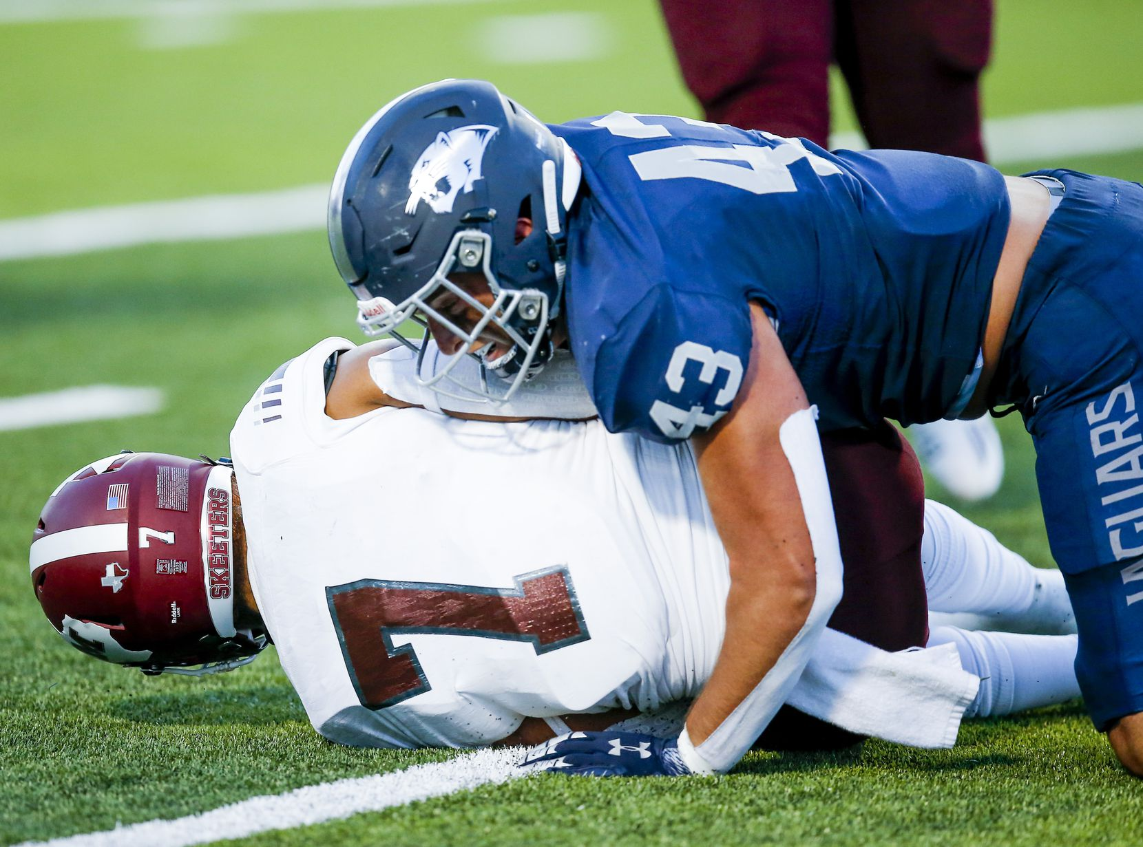 Flower Mound senior defensive end Jake Rumsey (43) sacks Mesquite senior quarterback Chance Edwards (7) during the first half of a high school football game at Flower Mound High School, Friday, August 27, 2021. (Brandon Wade/Special Contributor)