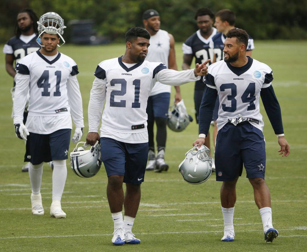 Dallas Cowboys running back Ezekiel Elliott (21) speaks with running back Darius Jackson (34) during organized team activities at Cowboys headquarters in Irving, Texas Wednesday May 25, 2016. (Andy Jacobsohn/The Dallas Morning News)