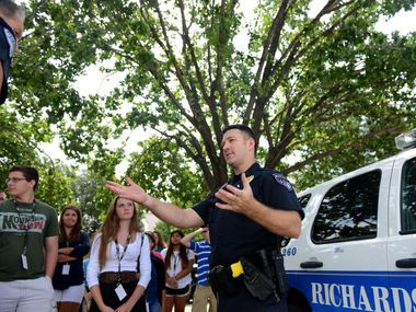 Richardson Police officer Cory Wendling speaks to students during a K-9 unit demonstration on the first day of the Youth Citizen Police Academy held in Plano. Class topics included firearm simulations, patrol tactics, criminal investigations and anti-bullying and decision making.