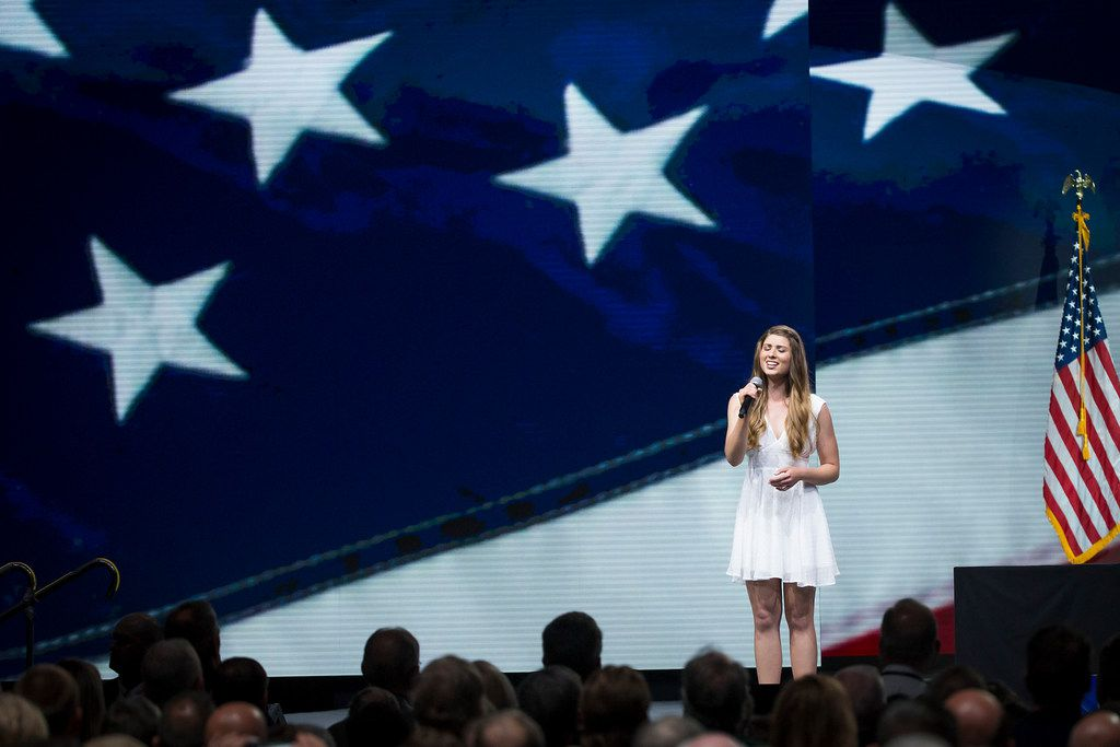 Lacey Caroline sings the national anthem at the NRA-ILA Leadership Forum at the Kay Bailey Hutchison Convention Center on Friday, May 4, 2018, in Dallas.