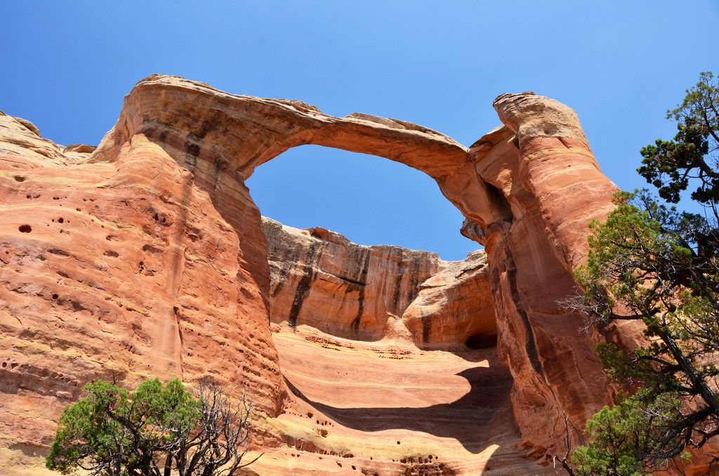 Colorful sandstone arches are the reward for a long, hot hike into Rattlesnake Canyon on the Colorado River.