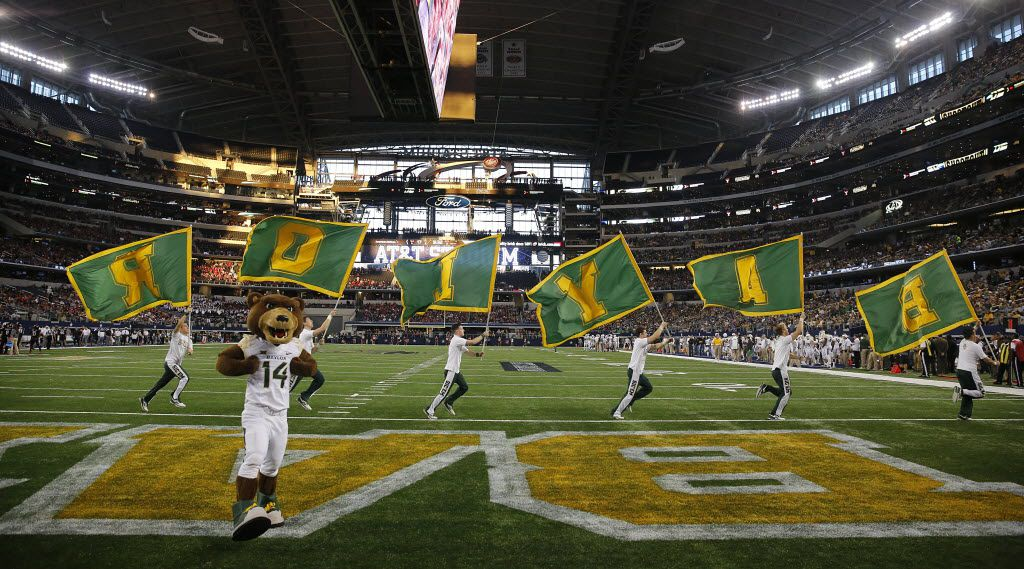 The Baylor Bears mascot and cheer squad celebrate a second half touchdown against the Texas Tech Red Raiders at AT&T Stadium in Arlington, Texas, Saturday, November 29, 2014. (Tom Fox/The Dallas Morning News)