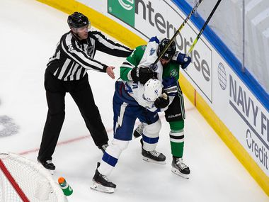 Jamie Benn (14) of the Dallas Stars battles against Jan Rutta (44) of the Tampa Bay Lightning during Game Three of the Stanley Cup Final at Rogers Place in Edmonton, Alberta, Canada on Wednesday, September 23, 2020. (Codie McLachlan/Special Contributor)