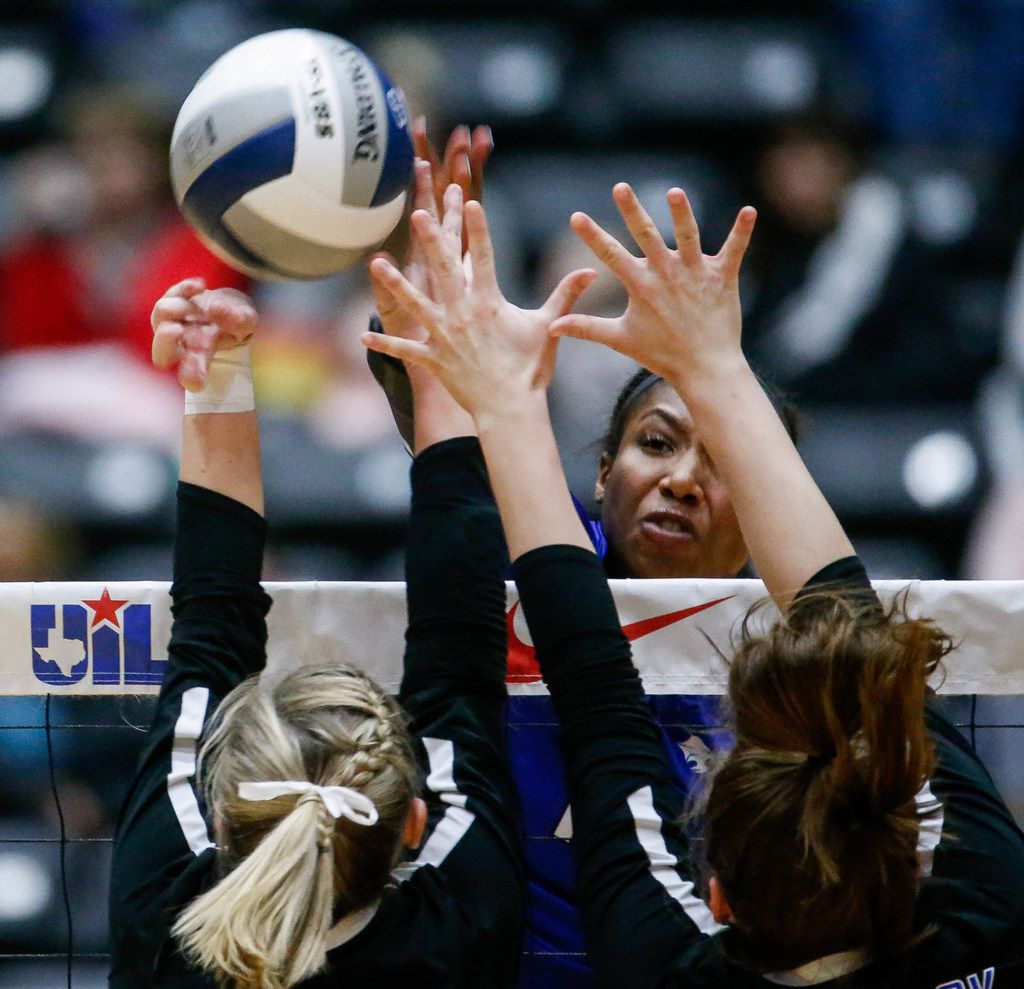 Trophy Club Byron NelsonÕs Charitie Luper (10) hits the ball over the net in the first set of a class 6A volleyball state final match against Plano West at the Curtis Culwell Center in Garland, on Saturday, November 23, 2019. Plano West won the first set 25-21.