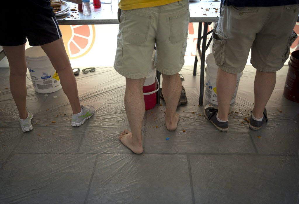 Adrian Morgan (center) goes shoeless during the Western Days Festival World Tamale Eating Championship Saturday, September 26, 2015 in Lewisville, Texas. A dozen competitors took part in the event, with the winner consuming 61 tamales in 12 minutes. (G.J. McCarthy/The Dallas Morning News)