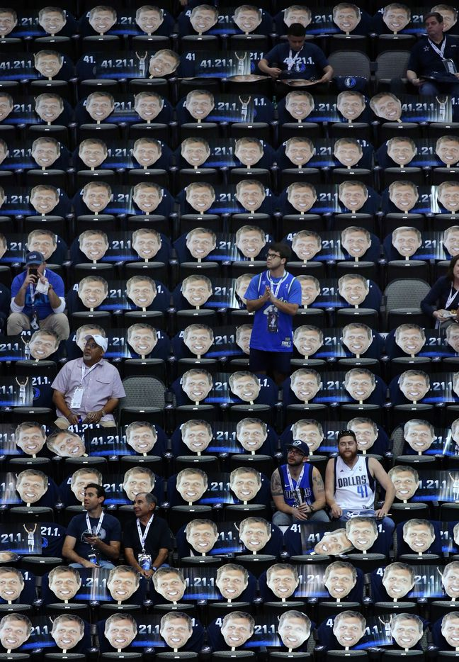 Dallas Mavericks fans arrive to see large cutouts of Dirk Nowitzki's head on the seats prior to his last home game of the season at the American Airlines Center in Dallas, Tuesday, April 9, 2019. Dirk will finish out his 21st season this week. (Tom Fox/The Dallas Morning News)