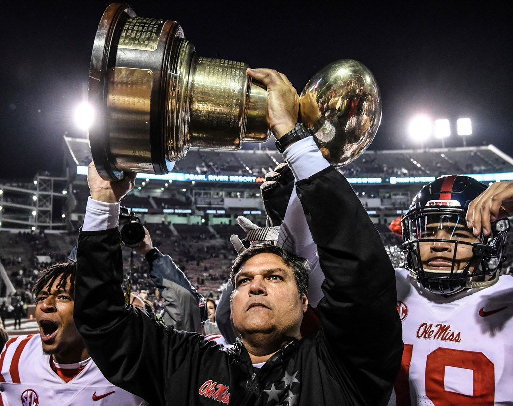 Mississippi interim coach Matt Luke holds the Golden Egg trophy following the team's 31-28 win over Mississippi State in an NCAA college football game in Starkville, Miss., Thursday, Nov. 23, 2017. (Bruce Newman/The Oxford Eagle via AP)