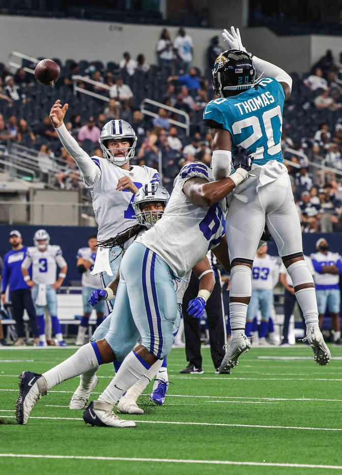 Dallas Cowboys quarterback Ben DiNucci, 7, makes a pass as Jacksonville Jaguars defensive back Daniel Thomas, 20, tries to block it during a preseason game at AT&T stadium in Arlington on Sunday, August 29, 2021. (Lola Gomez/The Dallas Morning News)