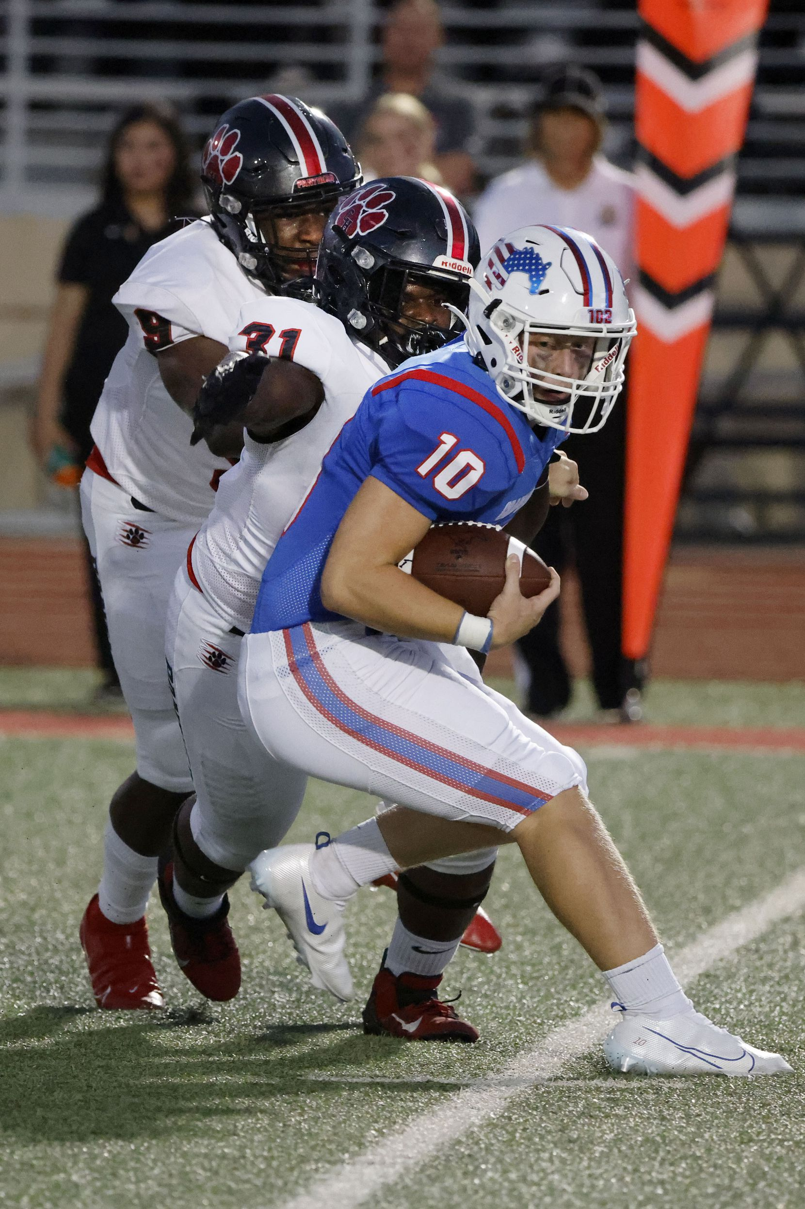 Grapevine quarterback Colt Mercer (10) is sacked by Colleyville Heritage defender Elijah Omar (31) with the assist of Garrett Finley (9) during the first half of their high school football game in Grapevine, Texas on Aug. 27, 2021. (Michael Ainsworth/Special Contributor)