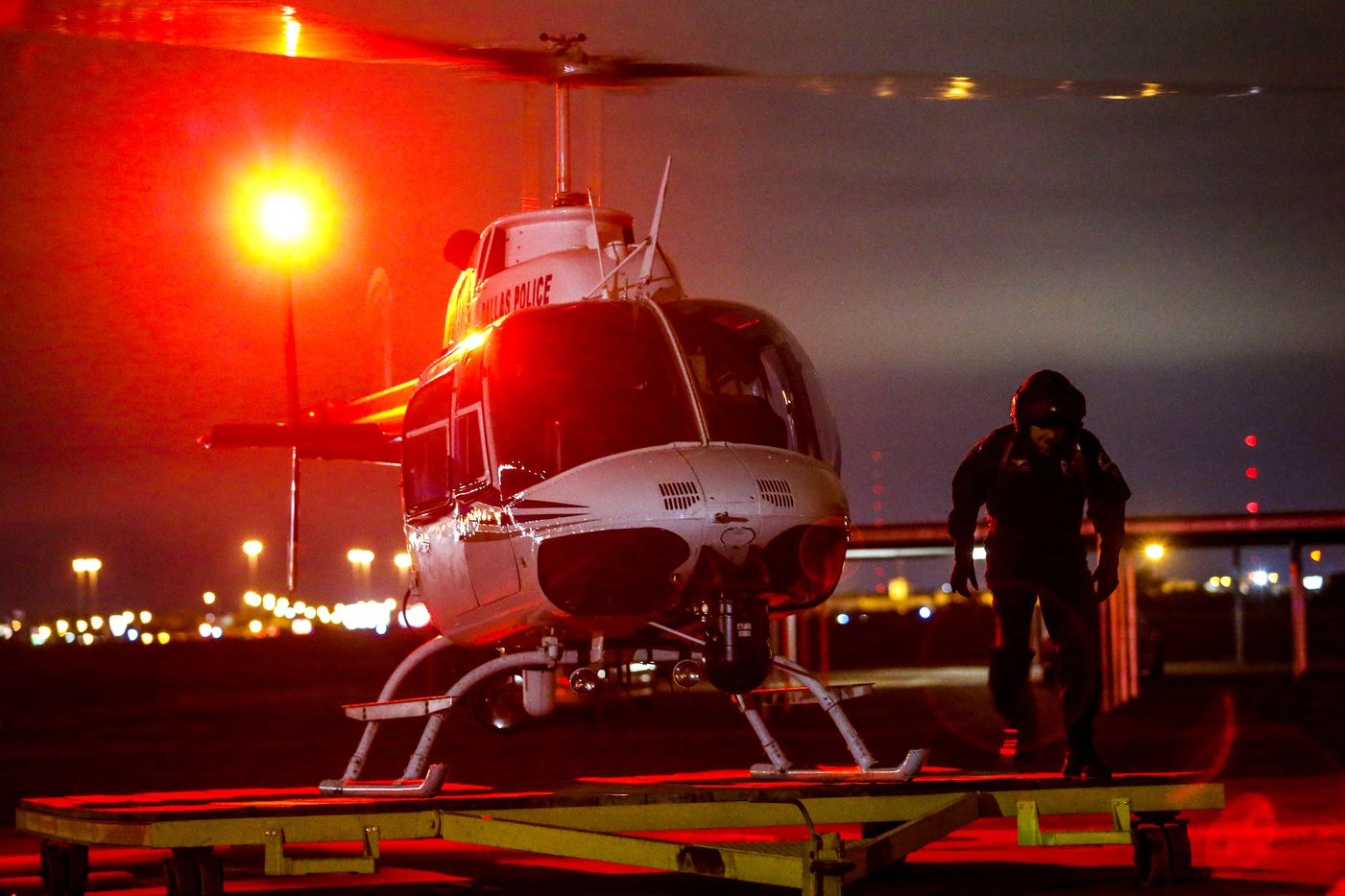 Dallas Police Helicopter Unit pilots senior corporal Rob Bryan, right, and senior corporal Mark Colborn, in helicopter, prepare to respond to a call to assist in a stolen car chase in the northwest police division after shots were fired at officers on Thursday, Oct. 31, 2019.