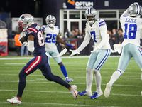New England Patriots wide receiver Kendrick Bourne (84) beats Dallas Cowboys cornerback Trevon Diggs (7) on a 75-yard touchdown  reception during the fourth quarter of an NFL football game on Sunday, Oct. 17, 2021, in Foxborough, Mass.